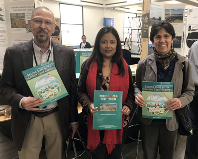 NIFA's Ali Mohamed, division director, division of environmental systems, Gyami Shrestha with the Carbon Cycle Interagency Working Group, and NIFA's Nancy Cavallaro, national program leader, division of global climate change celebrate Earth Day at the USDA's South Building cafeteria.